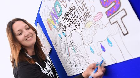Kate Housley of @One Alliance does some colouring in the Wellbeing Zone at the Innovate East confere