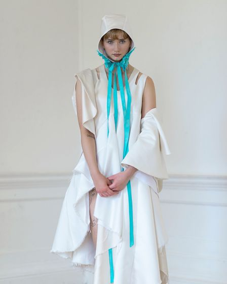 One of the wedding dresses from the Eternal Gift range designed by Jenna Martin for EACH using old b