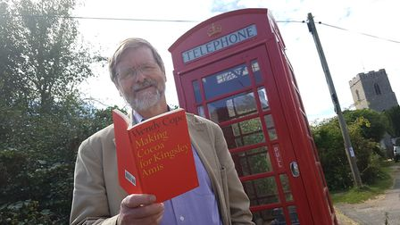 Co-organiser Peter Lincoln outside the phonebox in Great Glemham. PICTURE: RACHEL EDGE