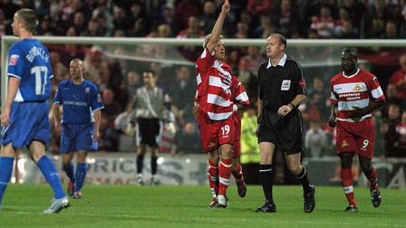 Ricky Ravenhill celebrates scoring the opening goal for Doncaster, in their Carling Cup success over