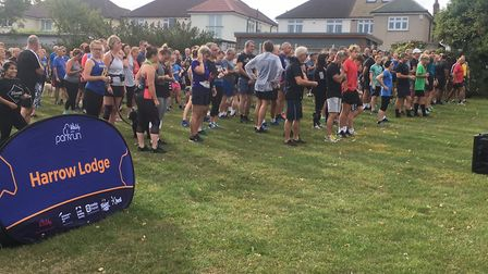 Runners and walkers congregate for the start of last Saturday's 334th staging of the Harrow Lodge pa