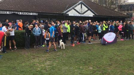 Runners and joggers assemble in front of Harrow St Mary's Pavilion befoe the start of the 195th Harr