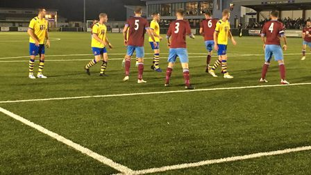 AFC Sudbury players (yellow) prepare to attack from another corner routine, although Deeping Rangers