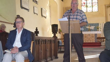 Richard Cuttell speaking at the public meeting in Theberton in opposition to Sizewell C, with Bill T