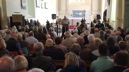 Richard Cuttell speaking at the public meeting held at St Peter's Church, Theberton over Sizewell C.