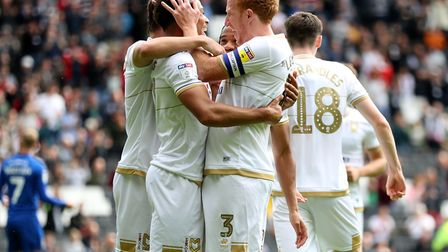 Sam Nombe celebrates after putting MK Dons ahead against rivals AFC Wimbledon. Photo: PA