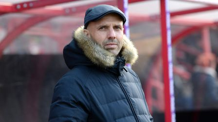 The flat cap fits: Paul Tisdale spent 12 years at Exeter City. Photo: PA