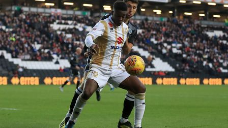 Kieran Agard (front) signed a new MK Dons deal after scoring 22 goals last season. Photo: PA