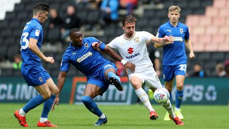 Former Colchester United midfielder� Alex Gilbey in action for MK Dons. Photo: PA