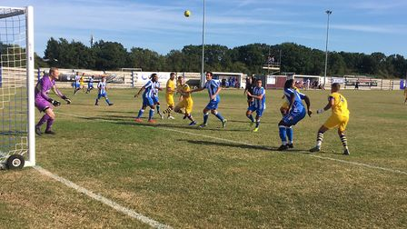 Goalmouth action from Saturday's Isthmian League North between Hullbridge Sports and AFC Sudbury. Pi