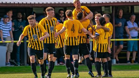 Jubilant Stowmarket Town players celebrate another goal during their 7-0 home win over Woodbridge To