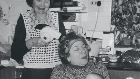 Phyllis demonstrates her hairdressing skills. She's attending to Devora Peake - 'a weekly event at t