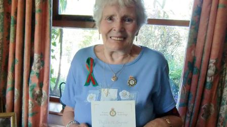 Phyllis Rose, aged 89, proudly holding her certificate of gratitude from Prime Minister Gordon Brown
