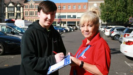 Nathan Chadwick signs the petition with nurse Nikki Ward Picture: MARK LANGFORD