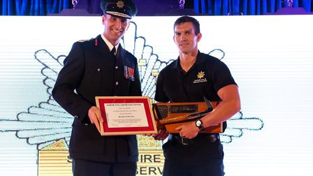 Chief Fire Officer, Mark Hardingham presents the Award for Recruit of the Year to Firefighter Michae