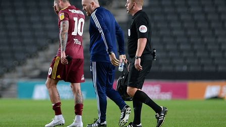 James Norwood leaves the field injured during the first half at Stadium MK Picture Pagepix