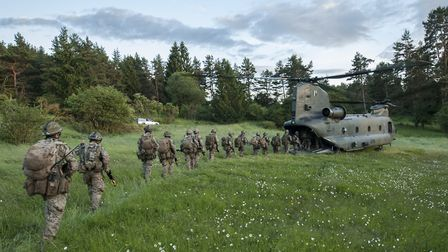 Troops file on to a Chinook helicopter Picture: CPL ROB TRAVIS / MoD Crown Copyright 2016