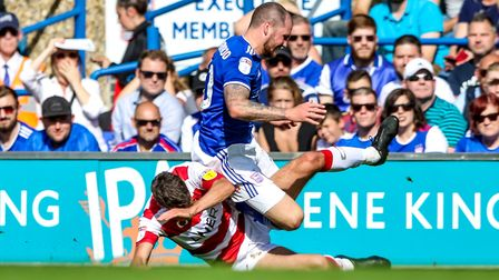 James Norwood is brought down by Matty Blair in the first half. Picture: Steve Waller www.step