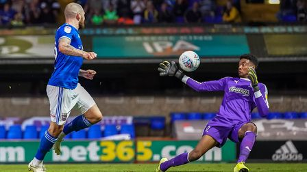 AFC Wimbledon keeper Nathan Trott saves a James Norwood effort late in the first half. Photo: Steve
