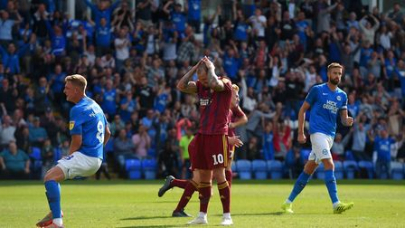 James Norwood holds his head after seeing a penalty saved at Peterborough. Photo: Pagepix