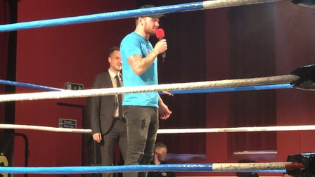 Ipswich Town striker James Norwood made a guest appearance at a charity wrestling match for Cancer R