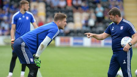 Tomas Holy receives instructions from Ipswich Town keeper coach Jimmy Walker. Photo: Pagepix