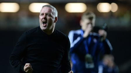 Ipswich Town boss Paul Lambert insists it's too early to talk about his side winning the League One