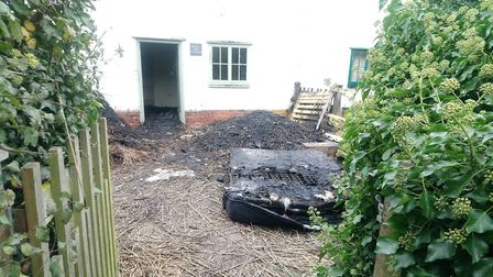 A burnt mattress sits outside the badly damaged properties Picture: ARCHANT