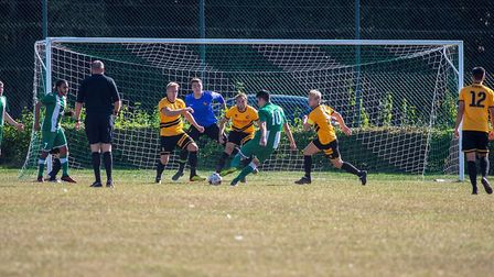 Pablo Chaves (number 10) scores the first goal for Whitton United against Mildenhall Photo: HANNAH P