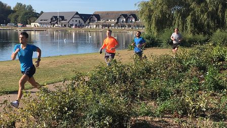 A picturesque scene as runners make their way alongside Willen Lake during last Saturday's Milton Ke