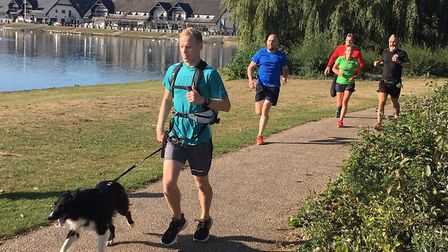 Runners and dogs approach the finish to last weekend's Milton Keynes parkrun. Picture: CARL MARSTON