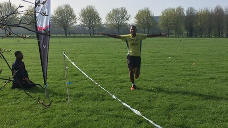 A runner is happy to reach the finish of the wonderfully low-key Beckton parkrun, held in the Boroug