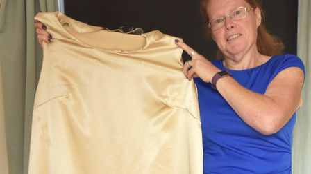 Slimmer Lynn Parker from Stowmarket with her wedding dress, which is now far too big for her. Pictur