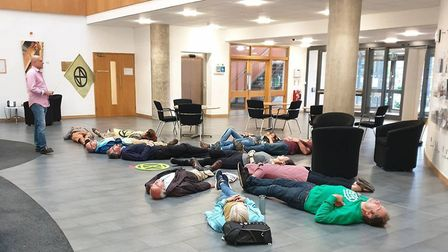 Extinction Rebellion protesters hold the 'die-in' in the lobby at West Suffolk Council Picture: EXTI