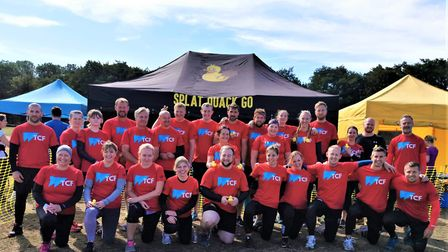 Tim Courridge and his team of 28 before diving into the mud for the Splat Quack Go fun run yesterday