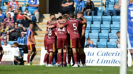 Ipswich players huddle up whilst celebrating their first half goal at Gillingham Picture Pagepix