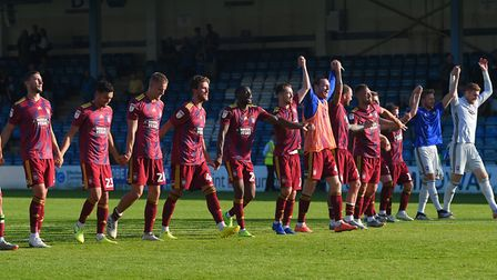 Ipswich players with a mass celebration at Gillingham Picture: PAGEPIX LTD