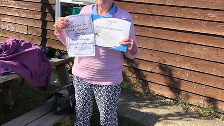 Alnog with her participation certificate, Mrs Mills grandson presented her with a 'World's Bravest G