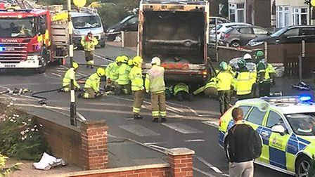 A motorcyclist has been freed by fire crews after being trapped under a bin lorry in Colchester Pict