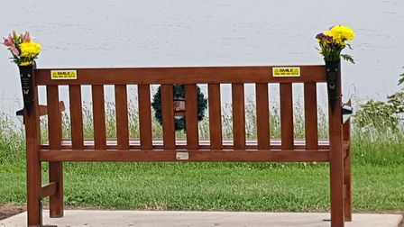 Flower pots on the bench, dedicated to Mark Garnham, were pulled off by vandals Picture: BARRY GARNH