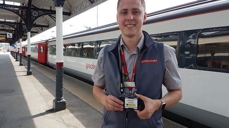 Greater Anglia conductor Nathan Long with one of the new cameras. Picture: GREATER ANGLIA