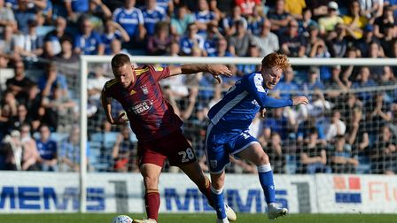 Luke Woolfenden sees off a challenge from Ben Pringle at Gillingham Picture Pagepix