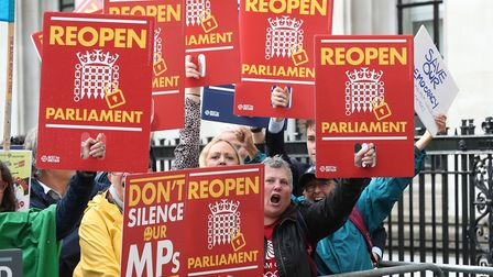 Protesters celebrating outside the Supreme Court in London, where judges have ruled that Prime Minis