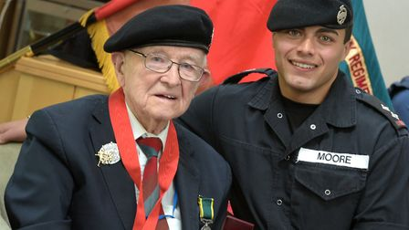 Tony Pyatt receiving pins for his 103rd birthday from Lieutenant Kyle Moore, who is the same rank a