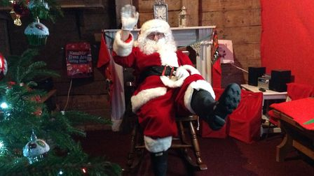 Father Christmas brings the festive season to Kersey Mill Photo: Baby Art UK
