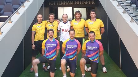 Craig Sawyer (centre) flanked by his Tour de Trigger cyclists in the tunnel at Tottenham Hotspur Sta