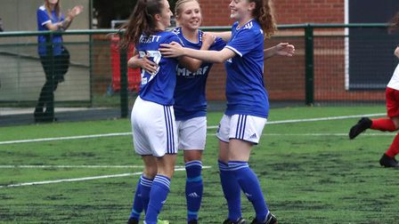 Amanda Crump celebrates one of her two goals with Sophie Peskett and Blue Wilson during Town Women's