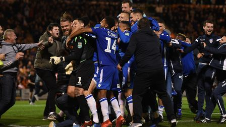 Colchester UNited fans invade the pitch after their victory over Tottenham during the Carabao Cup,