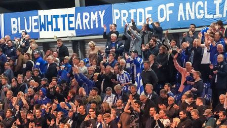 Colchester United fans celebrate after their side had knocked Spurs out of the Carabao Cup. Picture