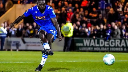 Frank Nouble converts his penalty in the shoot-out that saw Colchester United defeat Tottenham 4-3,